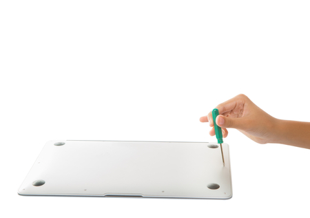 Female teenage hands unscrewing a back of a laptop