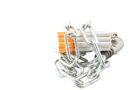 dependance: Concept image of cigarette addiction locked away
