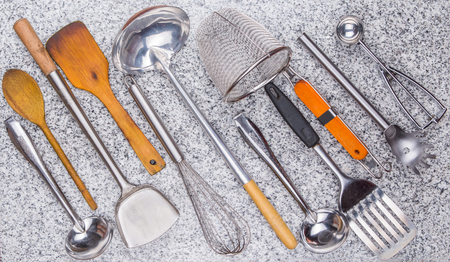 A collection of kitchen utensil on granite surface  photo