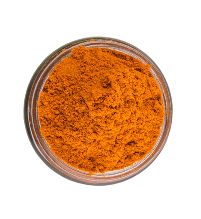 Curry powder spices over white background