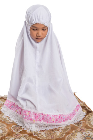 doa: Young Asian Muslim girl performing her prayer over white background Stock Photo