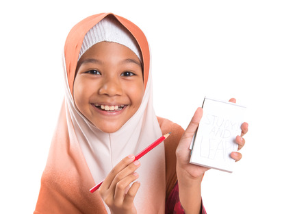 jot: Young Asian Muslim girl with notepad and pencil over white background