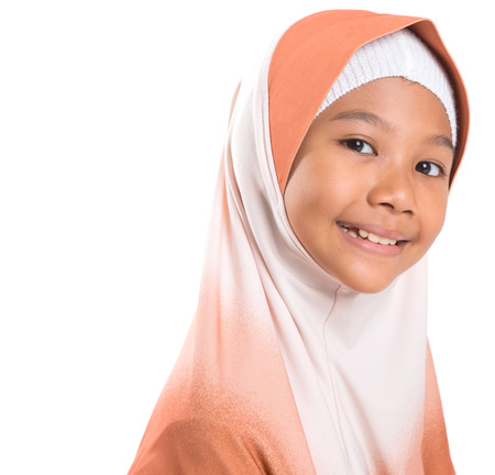 Young Asian Muslim girl with hijab over white background photo