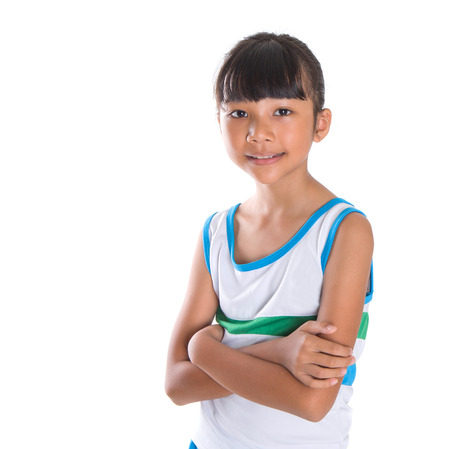 Young girl in athletic attire over white background