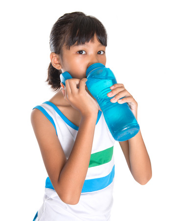 Young girl in sports attire with a bottle of water photo