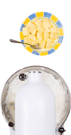 cake mixer: Mixing cake ingredients in standing mixer over white background Stock Photo