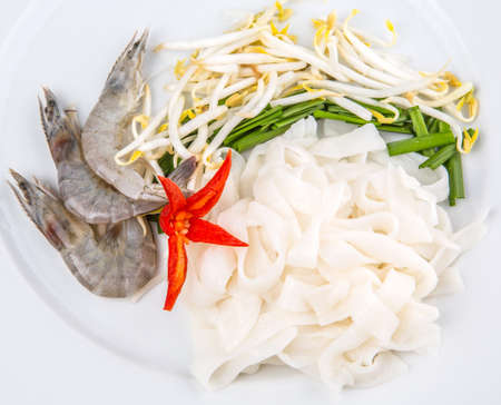 Fried char kway teow ingredients of raw rice strips, prawns and bean sprouts  photo