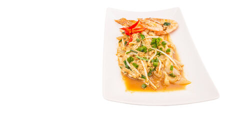 A plate of char kway teow with prawns and gravy photo