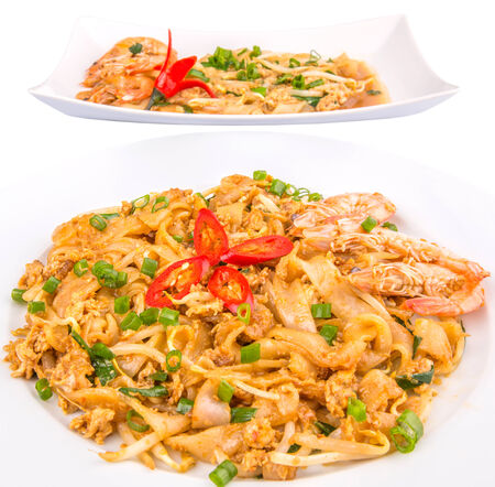 Different type of fried char kway teow with prawns and gravy photo