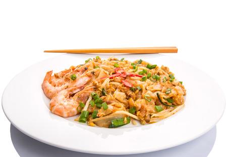 Fried char kway teow with prawns and chopstick Фото со стока