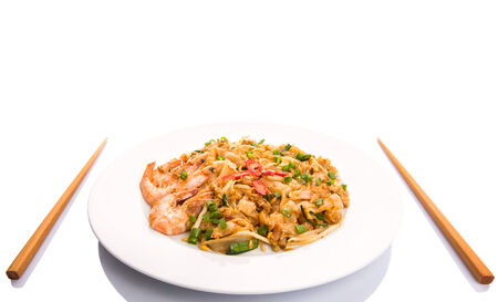 Fried char kway teow with prawns and chopstick photo
