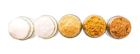 to refine: Brown sugar, muscovado sugar, white refine sugar, coconut sugar and rock sugar in a glass container Stock Photo