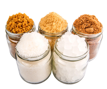sugar palm: Brown sugar, muscovado sugar, white refine sugar, coconut sugar and rock sugar in a glass container Stock Photo