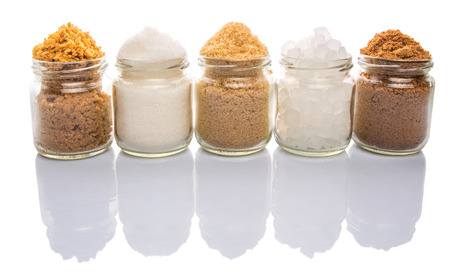 substitute: Brown sugar, muscovado sugar, white refine sugar, coconut sugar and rock sugar in a glass container Stock Photo