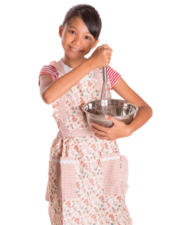 Young Asian Malay girl with egg beater and steel bowl over white background photo