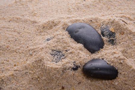 sediments: Zen stones buried in beach sand Stock Photo