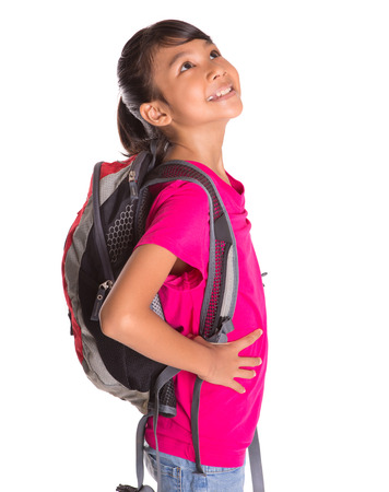 tween girl: Young Asian Malay girl student with a backpack Stock Photo