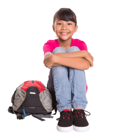 asian preteen: Young Asian Malay girl student with a backpack Stock Photo