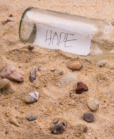 Concept image of a message HOPE in a bottle photo