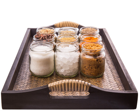 Sugar and spices in a wicker tray photo