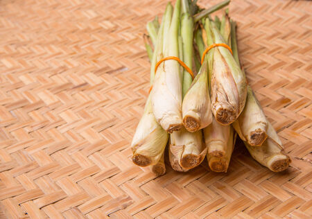 A bunch of lemon grass in wicker tray photo