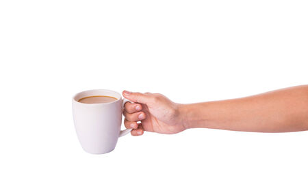 creamer: Woman hand holding a mug of coffee with creamer over white background  Stock Photo