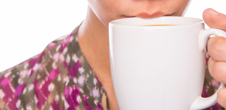 creamer: An adult woman sipping coffee with creamer