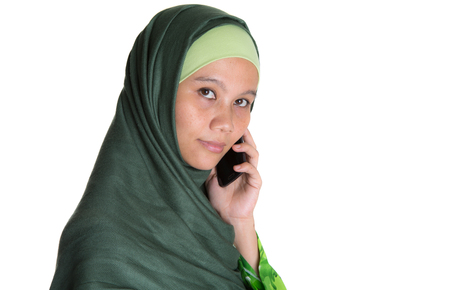 Muslim woman in hijab with a smartphone photo