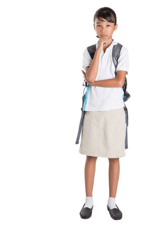 asian school girl: Young Asian school girl with backpack in school uniform over white background Stock Photo