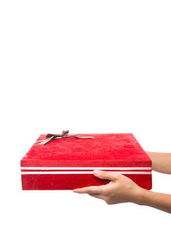 Female hands holding a red giftbox photo