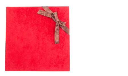 Red gift box over white background photo