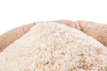 Rice in a gunny sack over white background photo