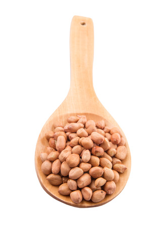 ground nut:  Ground nut or peanut on wooden spoon over white background Stock Photo