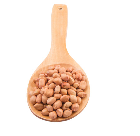 pygmy nuts:  Ground nut or peanut on wooden spoon over white background Stock Photo