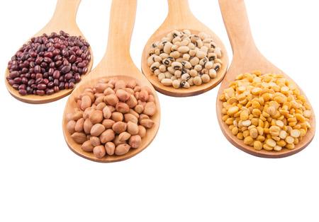 Peanut, dal lentils, black eye bean and adzuki bean on wooden spoon photo