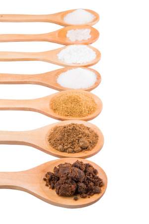 sucrose: Various type of sugar on wooden spoon over white background