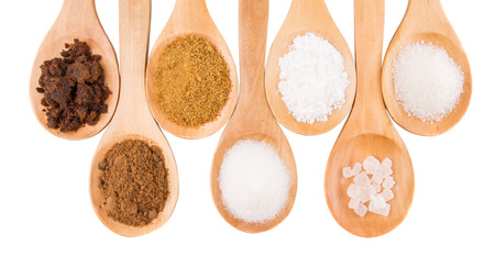 fructose: Various type of sugar on wooden spoon over white background