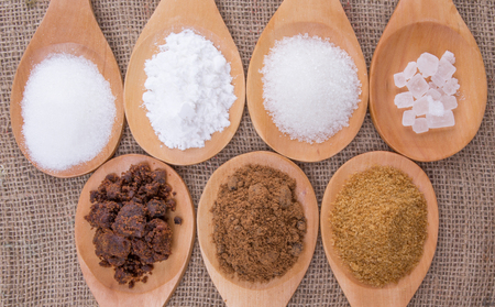 Various type of sugar on wooden spoon Stock Photo