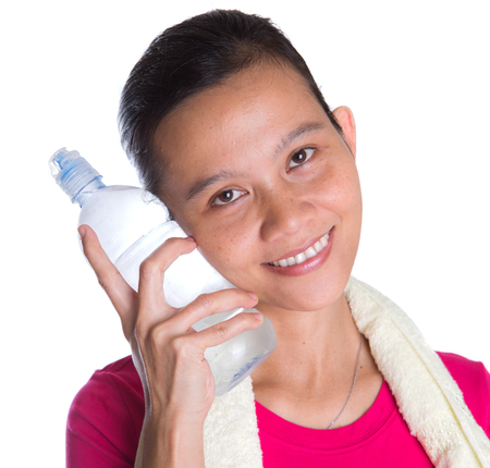 Female Asian in sports attire with a bottle of mineral water