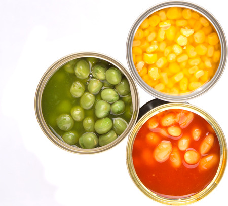 tinned: Baked beans, green peas and sweet corn in tin can over white background