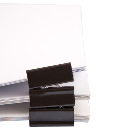 squeeze shape: Binder clips with black white paper over white background
