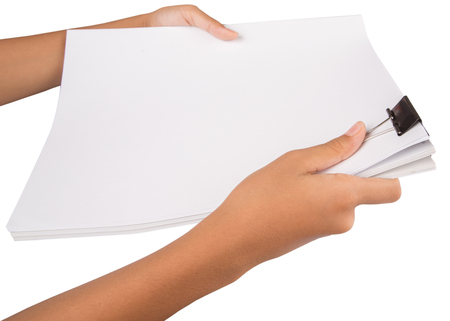 squeeze shape: Female hand holding white paper with binder clips over white background