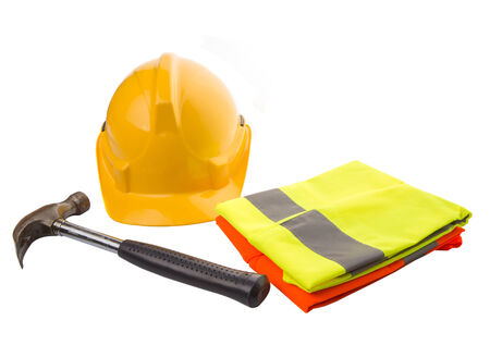 Yellow hard hat, a hammer and orange and yellow reflective best over white background  photo