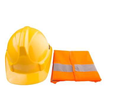 Yellow hard hat and orange reflective vest over white background photo