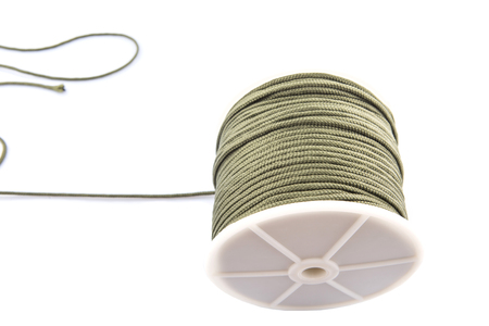 abseil: Green para cord over white background