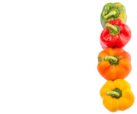 paprica: A group of different colors of capsicum over white background