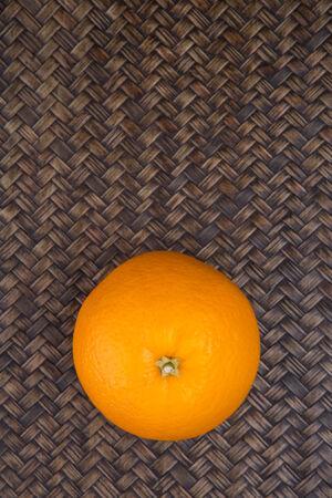 flesh colour: Orange fruits over wicker background