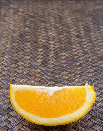 flesh colour: Slice of orange fruit over wicker background