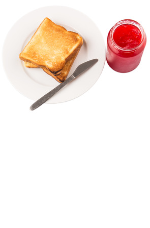 burnt toast: A bottle of strawberry jam and bread toast on a plate over white background Stock Photo
