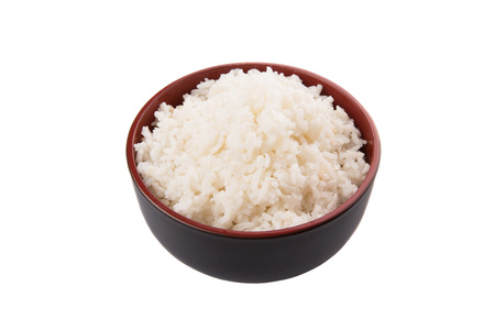 A bowl of rice over white background